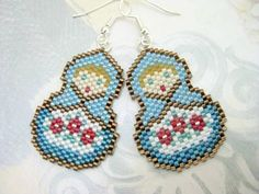 Precious hand made peyote stitched Matryoshka earrings.