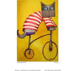 Gato euilibrista en triciclo