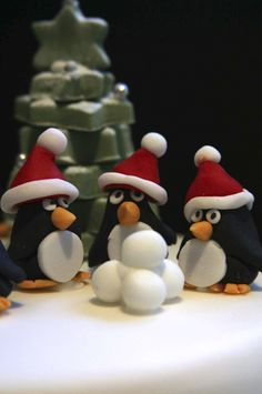 Novelty Penguin Cake topper on a vanilla sponge cake