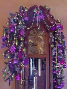 Our grandfather clock in his Christmas robe. This year he was dressed in glowing purples and greens.