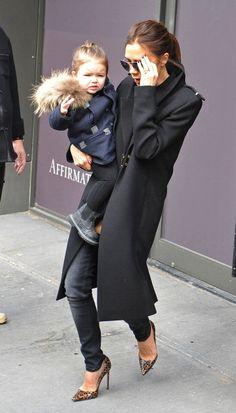 Waving to her fans while out with Mom in New York in 2013. See all of Harper Beckham's cutest looks.