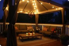Gazebo with lights, comfy seating, coffee table and lovely railing. Gorgeous with lights, comfy seating, coffee table and lovely railing. Outdoor Gazebos, Outdoor Spaces, Outdoor Living, Outdoor Decor, Outdoor Pavilion, Outdoor Ideas, Exterior Remodel, Interior Exterior, Cool Ideas
