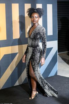 Lupita Nyong'o Photos - Lupita Nyong'o attends the European Premiere of 'Black Panther' at Eventim Apollo on February 2018 in London, England. Black Women Art, Beautiful Black Women, Beautiful Gowns, Black Panther Chadwick Boseman, Strong Black Man, Black Goddess, Hot Dress, Red Carpet Fashion, Star Fashion