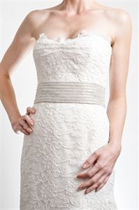 Pretty Belt by Badgley Mischka  Three-inch wide belt with rows of pearls, crystals and pallets.