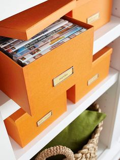 Labeled photo boxes are the perfect size for movie and video game storage.