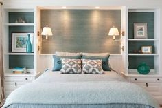 By now we realize the value and appreciation of a built-in bookcase to a small space design – it's the easiest way to combine functionality (they serve as a both a nightstand and dresser) and aesthetics. In this particular bedroom, the shelves are lined with a gorgeous green-toned grasscloth wall covering. In additional to crating interest on the walls through photo frames, a gallery wall or busy decoration it to make a pop though wallpaper, which in turn has the same affect on the eye.