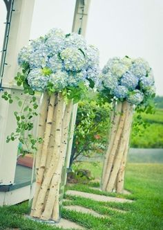 B E A U T I F U L. Very tall vases with birch branches topped with Hydrangea.