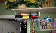 Wire basket makes for cheap, easy and organized  ribbon holder. Just pick a color and pull .