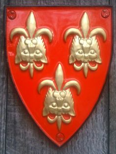 Gules, three leopard's heads reversed jessant-de-lis or.  Hereford, derived from Cantilupe.