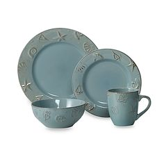 """Dusty blue dinnerware is embossed with a seashell design to add a fresh  touch to any table. Stoneware is microwave safe for reheating and dishwasher safe. Four 10.5"""" dinner plates Four 8"""" salad plates Four 6"""" soup bowls Four 13 oz. mugs $40"""