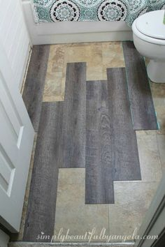 This peel and stick tile also made this bathroom floor look amazing – I can't even tell it isn't wood! Plus Remodeled Bathroom Ideas | Inspiring Makeovers on a Budget on Frugal Coupon Living. #remodelingbathroom