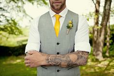 Groom with grey waistcoat and yellow tie - Picture by Marianne Taylor Photography