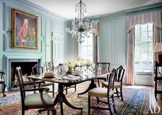 In the dining room of a historic Washington, D.C. home, a circa-1880 George III–style chandelier from Kentshire is suspended above an antique double-pedestal table from the Shop; the Georgian chairs are a mix of antiques and reproductions, and the curtain fabric is by Rose Cumming.  DESIGNER: Gomez Associates Inc. PHOTOGRAPHER: Scott Frances
