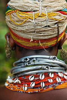 India | Details from the traditional dress of a tribal Bonda woman at the weekly Sunday market held in Mundiguda. Orissa  | © Kimberley Coole