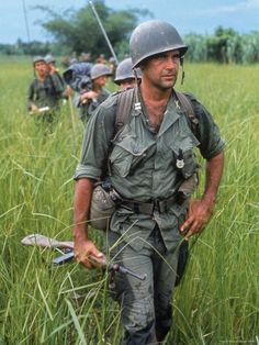 recognize anybody like that dad mel g miller? US Army Captain Robert Bacon leading a patrol during the early years of the Vietnam War, photo by Larry Burrows 1964 ~ Vietnam War Vietnam War Photos, North Vietnam, Vietnam Veterans, Military Veterans, Military Personnel, American War, American Soldiers, American Stock, Life Magazine
