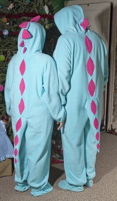 Ya, we need these matching Dino footie pajamas | His and Hers, Pastel Dinosaur Footie Pajama's, w/tails!! xoxo / Our Kiddo would be stoked to wake up X-Mas morning, and come out to his parental units wearing candy colored dino footie's!