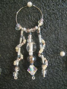 A set of glass charms made for a friend's relative's wedding. One of the beads is a #swarovski, guess which one? ;-)