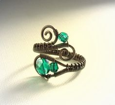 Emerald green copper ring wire wrapped antiqued rustic handmade jewelry with Swarovski crystals. $24.00, via Etsy.