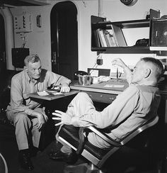 U.S. Admiral William Halsey (right), commander of the 3rd Fleet, U.S. Navy, talks with Vice Admiral John McCain on board the battleship USS New Jersey (BB-62 ) on the way to the Philippines, December 1944.