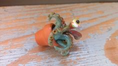 Creepy plant with eyes and tentacles dollhouse miniature in one inch scale ooak 1:12