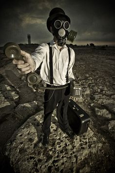 """The apocalypse is coming: what you need to pack.""   Apocalypse Calling, it's the end of the world as we know it!  Masked man, face mask, gas mask, dystopian world, society, post apocalyptic world.  Conceptual photography. Art.  -Lindseigh"