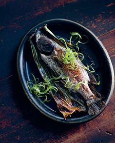 Snakehead fish smoked in rice straw recipe from The Food of Vietnam by Luke Nguyen | Cooked