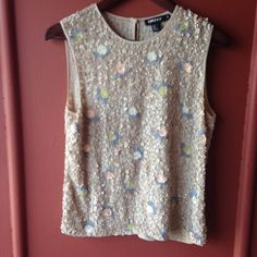 DKNY sequin top Sleeveless sequin top in really good condition, too small for me. ❌NO TRADES DKNY Tops