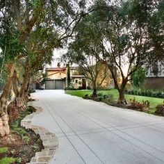 Driveway hugged by planting beds