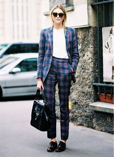 Matching plaid suit creates a bold look.
