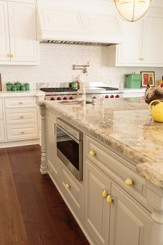 Take a tour of this colorful cottage kitchen. It blends traditional style with whimsical color to create a charming kitchen with plenty of style. Pull Out Kitchen Faucet, Kitchen Redo, New Kitchen, Kitchen Design, Kitchen Ideas, Kitchen Faucets, Country Kitchen, Kitchen Interior, Quartz Kitchen Countertops