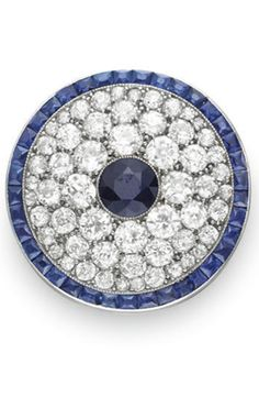 A BELLE EPOQUE SAPPHIRE AND DIAMOND BROOCH, BY CARTIER  Of circular outline…