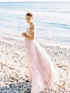 This Joelle Perry dress is perfect for a beach ceremony: http://www.stylemepretty.com/2015/05/19/the-prettiest-blush-pink-wedding-dresses/