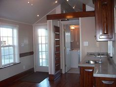 $24,000 plus delivery--The Holly Pond Cottage is really beautiful inside and out with lots of light and yet a real cozy secure feeling inside. Notice the pressure treated timbers used for the foundation frame. 2X6 exterior stud walls. R19 plus (with extra pocket airspace) in floor, walls, and ceiling.: