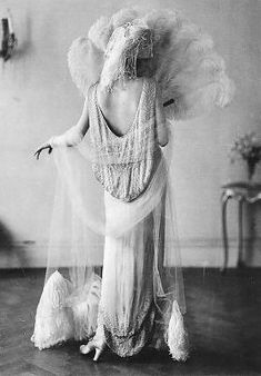 1920s ostrich feathers, beading and a low cut back dress