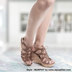 067553e7baa Walk high in these gladiator inspired lace up high wedge heels