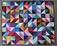 Colorful triangle quilt.