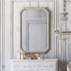Eloquence® Vienna Mirror in Frosted Wood finish with gently aged mirror glass. A classic Italian-inspired shape bordered by expertly carved wooden moldings.53x35