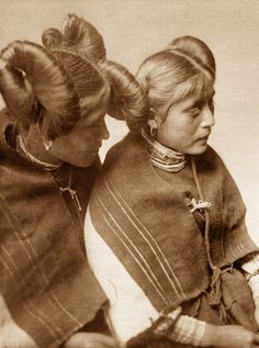 Pulini and Koyame, 1922, Edward S. Curtis. Members of the Walpi tribe in Arizona. This one is strange to me because I thought I was quite familiar with American Indians but I've never heard of the Walpi before nor have I seen this odd hairstyle they wear.