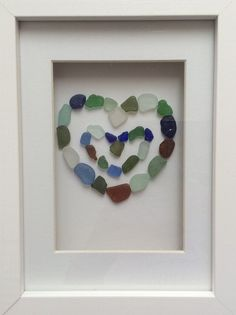 Mixed colour double love heart seaglass picture in box frame.  This picture is made from tiny pieces of seaglass, all collected by hand from the beaches near my home in the a East of Scotland. The picture is in a white wood box frame measuring 7 x 5. It can be wall mounted or free standing.  A lovely gift or decoration for any home full of love. Perfect as a wedding gift, birthdays or anniversaries.