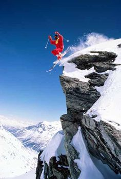 This heli-skier launches off a cliff in Valgrisenche, Italy. Helicopters drop the skiers off on remote mountain slopes