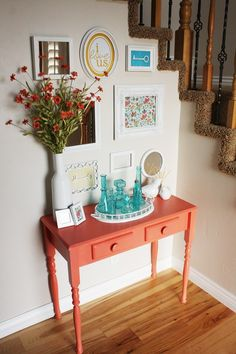 I like the idea of a refinished table in a focal color in the entry. I may have to give this a shot! Color!!