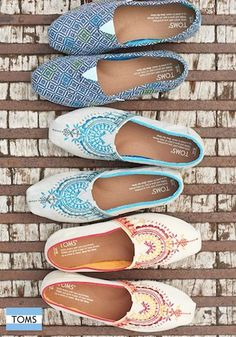 Click to shop the latest TOMS Classics for her. Buying a pair gives a pair.