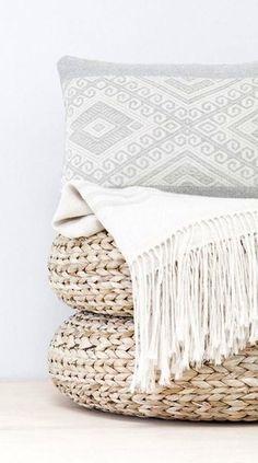 white throw, textured white cushions, cane foot stools