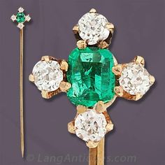 Victorian yellow gold stick pin set with a central cushion cut emerald carat) surrounded by four old European cut diamonds carat total weight, H-I color, SI clarity). Diamond Hair, Diamond Cuts, Edwardian Jewelry, Antique Jewelry, Victorian Hats, Enlarge Photos, Tie Pin, European Cut Diamonds, Stick Pins