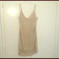 Alice & Olivia pretty gold sequin dress NWT size 4 Alice & Olivia gorgeous stunning gold sequin dress size 4 NWT! There is a small patch of beads missing on the left chest area. See picture. That's the reason for the amazing deal! I bought this at a department store on sale and that's the only thing wrong with it. Never been worn NWT Alice + Olivia Dresses Mini