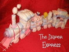 Diaperzoo.com Diaper cake instructions, baby gifts, baby shower, center piece, babies, shower ideas,