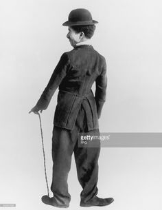 British-born comic actor Charles Chaplin (1889 - 1977) in character as his movie alter-ego, circa 1920.