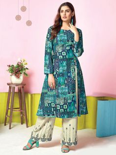Excursive Designer Top And Bottom Set Tucute By Karma Trendz Designer Kurti And Palazzo Set Indian Designer Suits, Designer Kurtis, Salwar Suits Simple, Salwar Suits Pakistani, Salwar Suits Party Wear, Turquoise Fabric, Indian Dresses, Indian Suits, Indian Wear