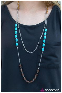 Product Description  A mishmash of wooden beads and sea-blue discs coalesce into an airy display. Complemented with a simple silver chain, the double chain compilation creates an elegant elongating effect.  Sold as one individual necklace. Includes one pair of matching earrings.