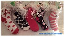 Filled Fuzzy Stockings with Mary Kay Mint Bliss Foot Energizing Cream, Extra Emolient Cream and Christmas candies.